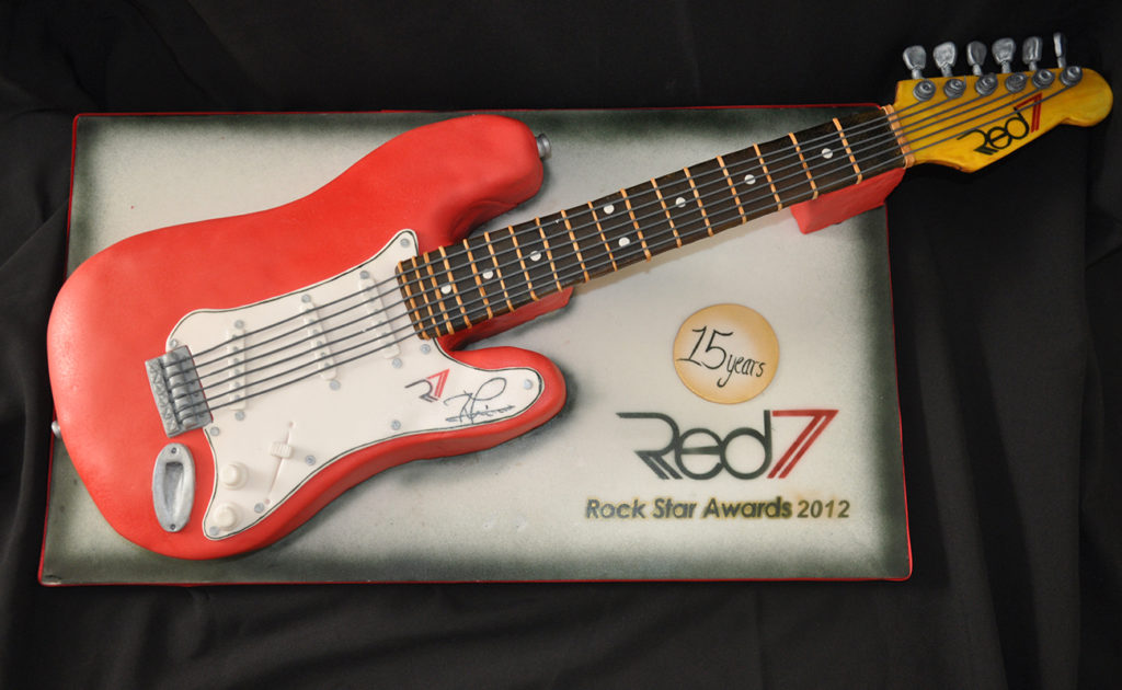 red fender guitar cake made from cake