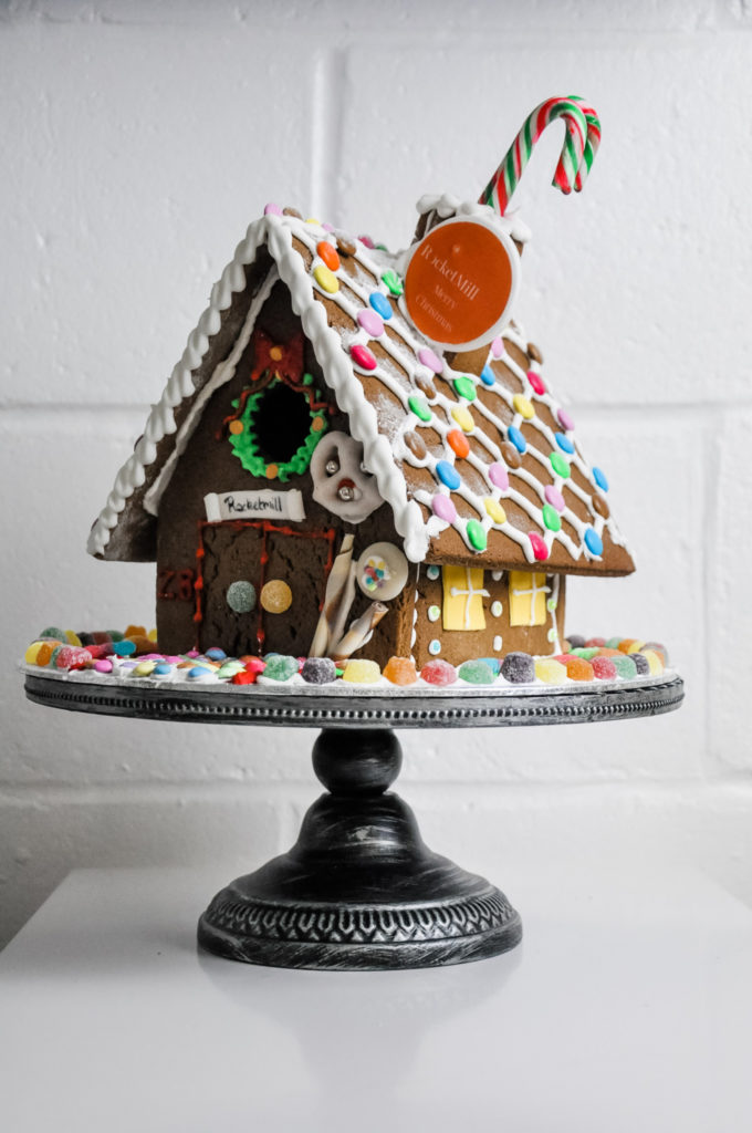 rocketmill branded gingerbread house in bright colours and orange