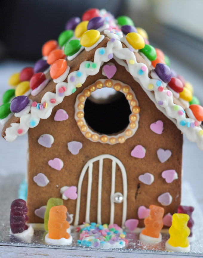 Vegan gingerbread house decorated with vegan sweets
